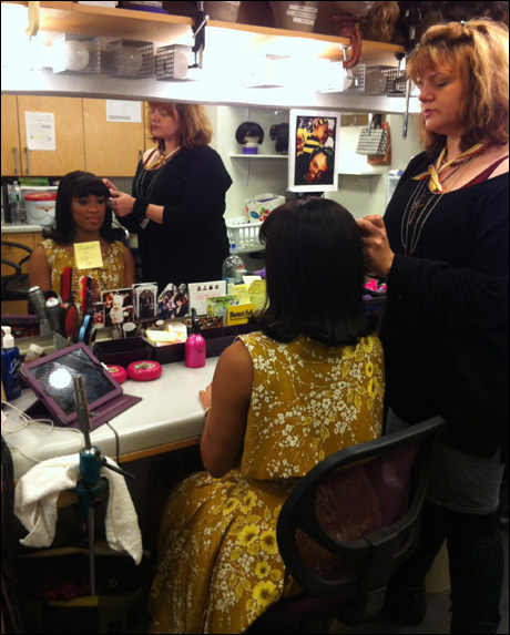 2:04: When I arrive in the hair room to get my wig put on by Jenn Mooney-Bullock, Wig Whisperer, Rashidra Scott is always just finishing. We are all assigned wig call times, starting as early as half hour. Mine is the downbeat of the overture.