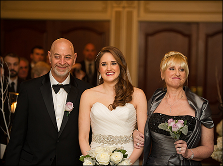 "Blair Goldberg:  ""Neither of my parents are performers, however they always instilled a love of musicals in me from a very early age. Here they are walking me down the aisle at my wedding."""