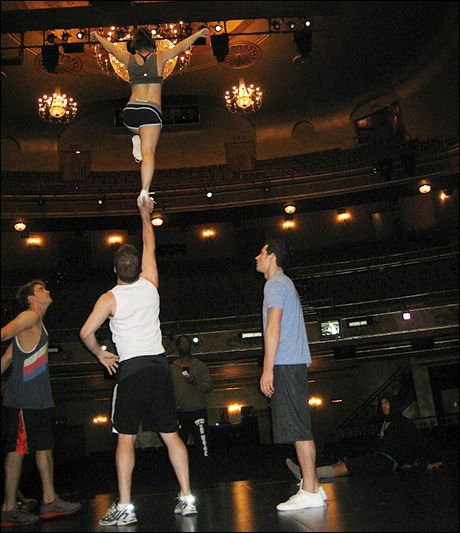 "David Ranck holds Lauren Whitt up with just one hand! In cheer lingo, we call this a ""one-arm liberty."""