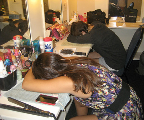 Haley Hannah and Calli Alden are ready early, so they sneak in a nap before the top of act one.