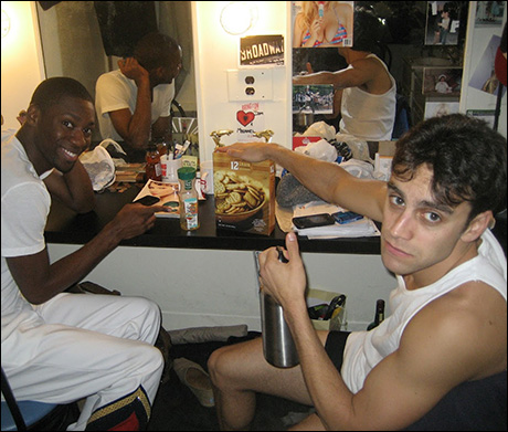 Dominique Johnson and Michael Mindlin finish up some snacks before they get into mics and costumes.