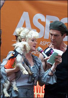 Christine Ebersole and Rupert Everett present a dog