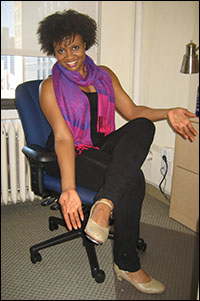 Actress Kelechi Ezie, currently in rehearsal to play Celie in <i>The Color Purple</i> for White Plains Performing Arts Center, shows off her character shoes.