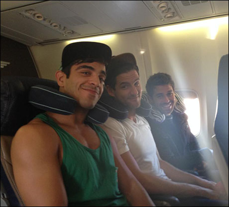 Jeff, John, and Josh settling in for the flight with their cutie little neck pillows! (Joshy is using mine).
