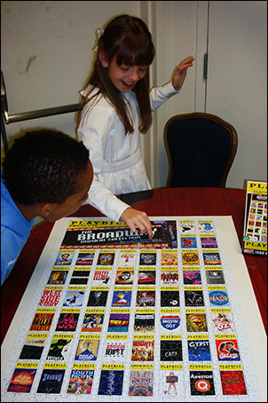 She even has time to put the last piece of the puzzle in place! 1000 piece Broadway Playbill puzzle finished!