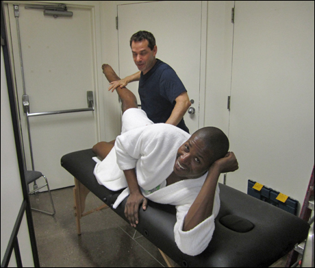 Lawrence Alexander gets some much appreciated Physical Therapy.