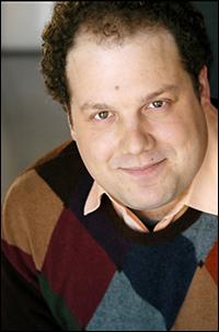 Jordan Gelber stars as Buddy the Elf