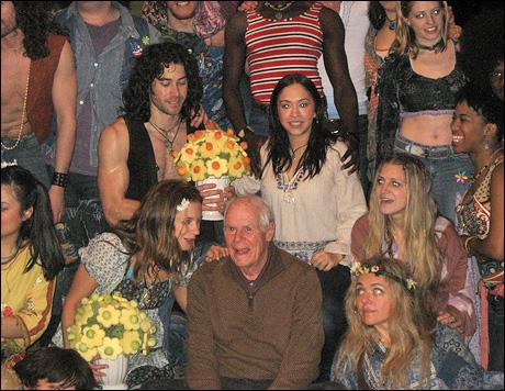 Galt MacDermot (center) and cast members