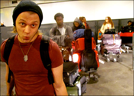 Matt DeAngelis, Brandon Pearson and a long line of tired looking hippies pick up their luggage across the pond.