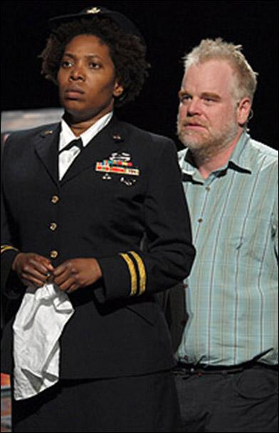 Saidah Arrika Ekulona and Philip Seymour Hoffman in the 2009 Off-Broadway revival Othello.