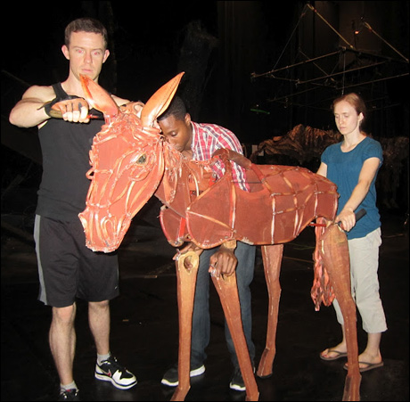 Baby Joey and his puppeteers Hunter Canning, David Pegram and Hannah Sloat, get reacquainted prior to this evening's performance. Unique for Baby Joey, these talented puppeteers actually switch positions every show.