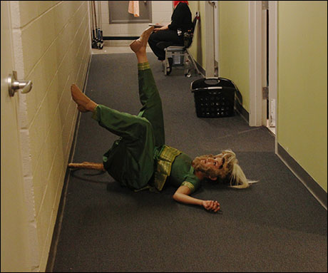 What else is happening at intermission? Anjali stretches in the hallway.