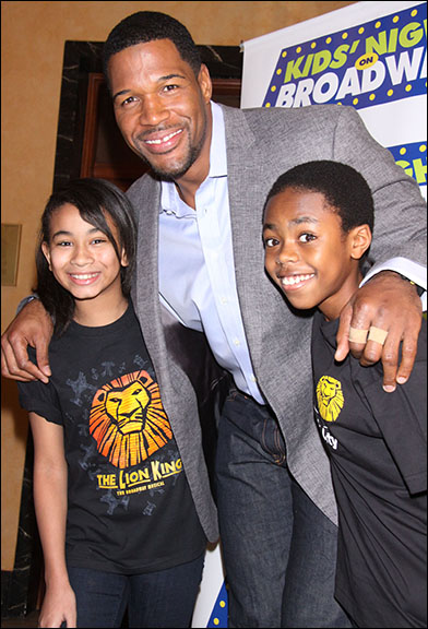 Michael Strahan with Alonie Dowden and Derek Johnson of The Lion King