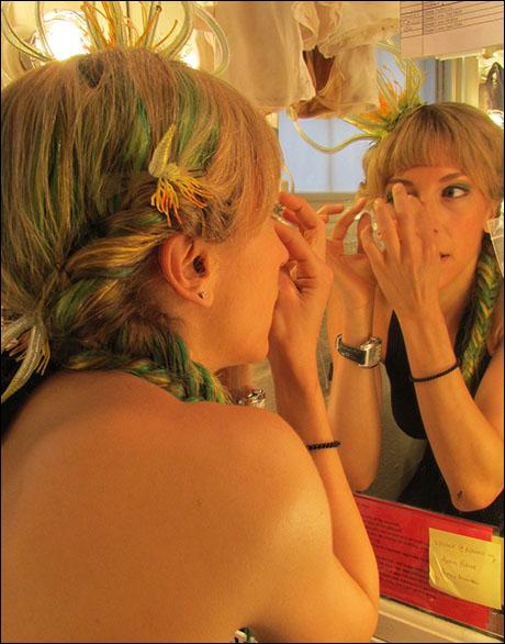 Erica putting on her eyelashes