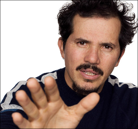 John Leguizamo: You're a young cop whose partner has drawn his gun on a guy with a knife, making one last try to get everyone to chill out and put away the weapons.