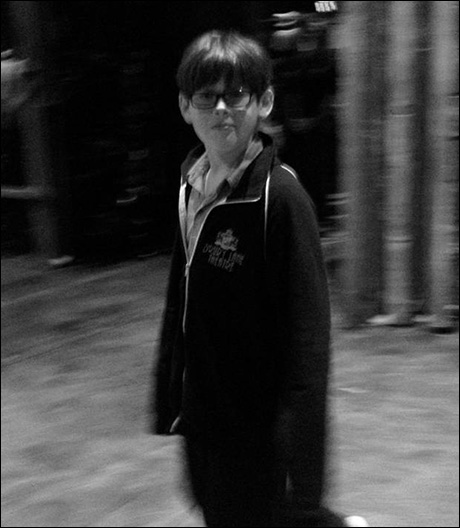 Johnny Rabe tries to stay warm on stage during rehearsal with his Drury Lane Theater zip-up. Such a theater kid, we love him.