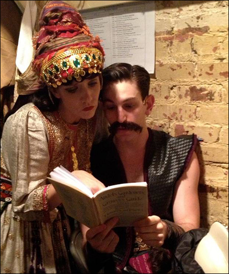 Having fun while waiting in the wings… Jenifer Foote and Harris Milgrim backstage have borrowed Gregg Edelman's prop – an instruction manual on planting and farming corn.