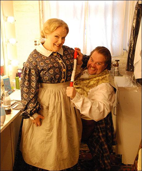Jessica Sheridan (Widow Corney) and John Treacy Egan (Mr. Bumble) get into character.
