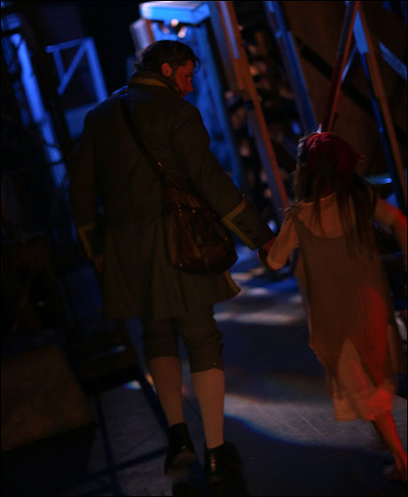Louis Hobson (Jean Valjean) walks backstage with Anna Ostrem (Young Cosette).