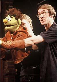 Rick Lyon, with Jennifer Barnhart (background), in <I>Avenue Q</I>