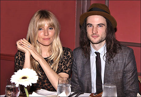 Sienna Miller and her fiancé Tom Sturridge celebrate Tom's Outer Critics Circle Award at the The 63rd OCC ceremony on May 23.