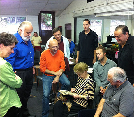 Jo Sullivan Loesser signing autographs at rehearsal
