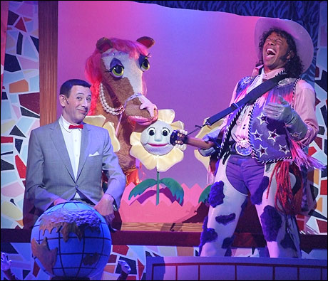 Paul Reubens as Pee-wee Herman and Phil LaMarr as Cowboy Curtis