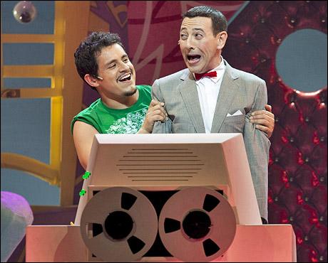 Jesse Garcia as Sergio and Paul Reubens as Pee-wee Herman