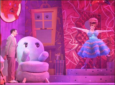 Paul Reubens as Pee-wee Herman and Lynne Marie Stewart as Miss Yvonne
