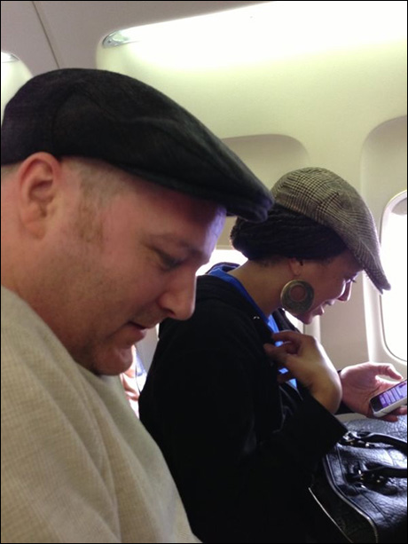 Typical plane behavior.  Hats, buried in our devices before they shut the doors.  With Sean Jenness and Wendy Fox.
