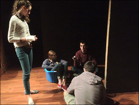 Playwright Paul Downs Colaizzo talking things out with cast members Lauren Culpepper, Zosia Mamet (in a laundry basket), and David Hull.