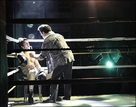 Cornerman Mark Zimmerman tends to Rocky during the first fight while bets are placed around the ring. The lighting is deeply intertwined not only in the traveling and side towers but also in the set units for Rocky's apartment and the pet shop.