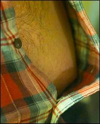 Seth opens his shirt