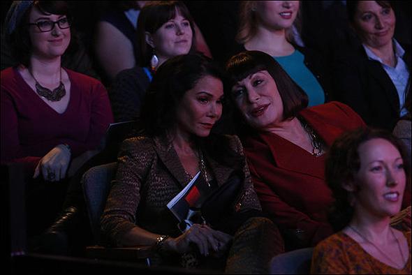"Daphne Rubin-Vega (""Agnes"") and Anjelica Huston (""Eileen Rand"") in Season 2, Episode 13: ""The Producers"""