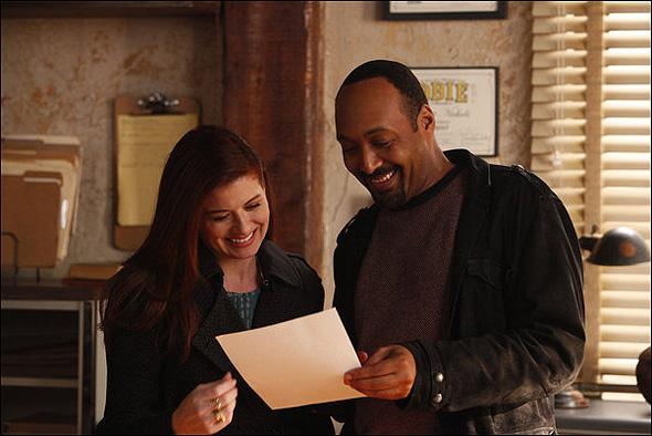 "Debra Messing (""Julia Houston"") and Jesse L. Martin (""Scott Nichols"") in Season 2, Episode 13: ""The Producers"""