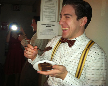 Adrian Aguilar (Artie Green) enjoys some cake. He also enjoys a cake track, only appearing onstage for 14 minutes 50 seconds (we timed it), and never in the second act. But it's definitely the best 14 minutes and 50 seconds of the play.